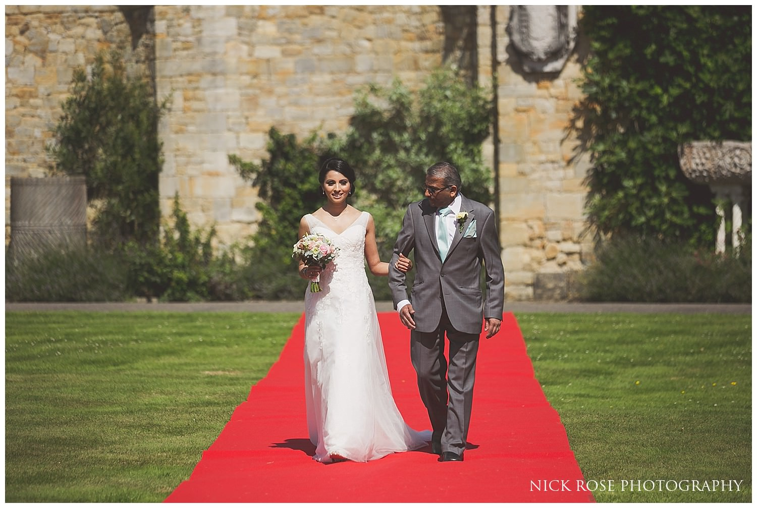 Father of the bride walking daughter up the aisle at hever castle