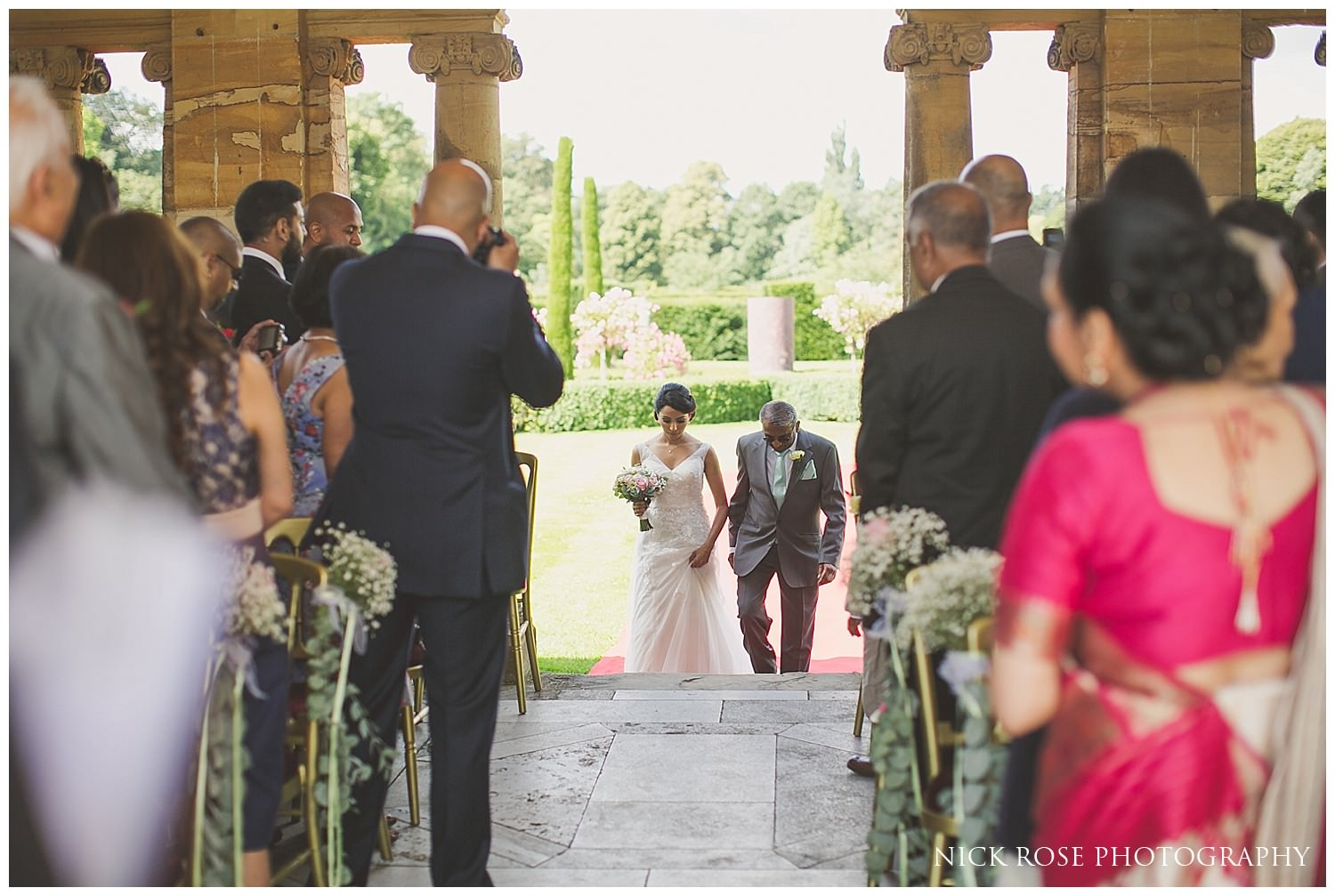 Father of the bride walking his daughter up the staircase at hever castle