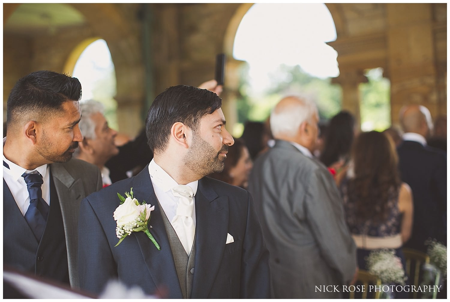 Groom's reaction to seeing his bride walking up the aisle at Hever Castle
