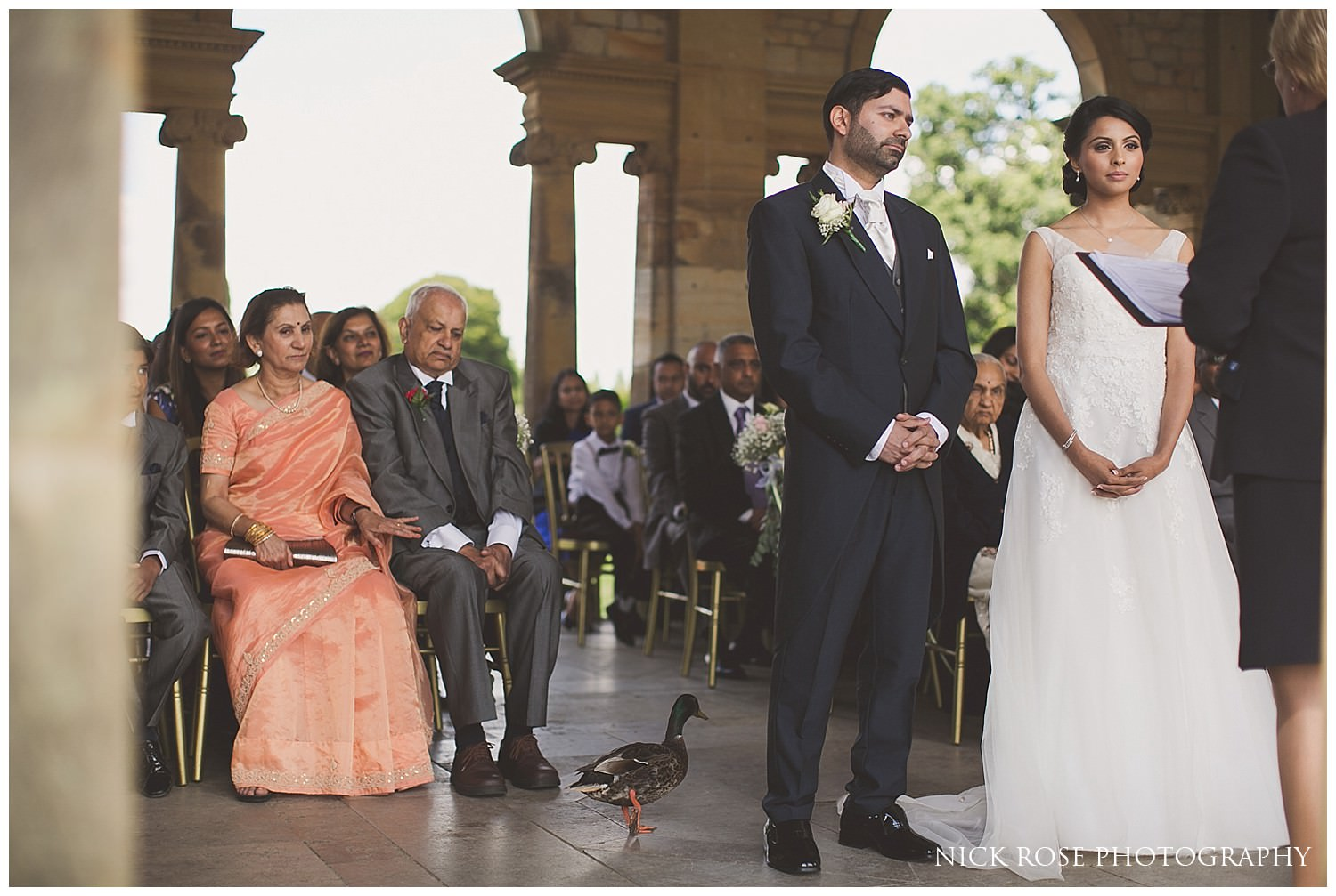 Bride and groom and ducks during a Hever Castle garden wedding in Kent
