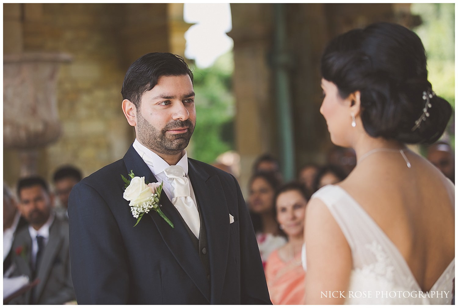 Bride and groom saying wedding vows at Wedding ceremony at Hever Castle