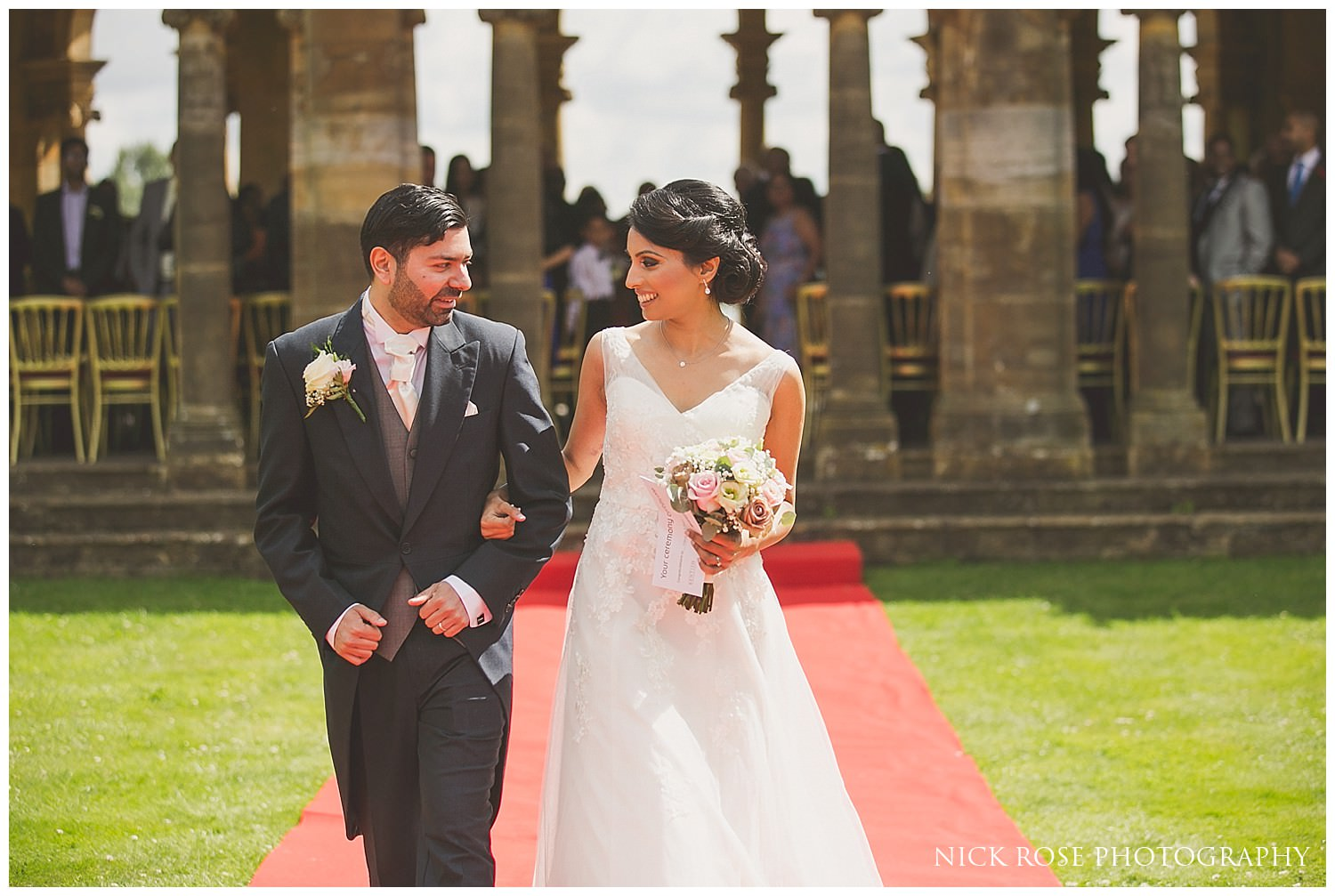 Bride and groom walking down the aisle after a wedding ceremony at Hever Castle Kent