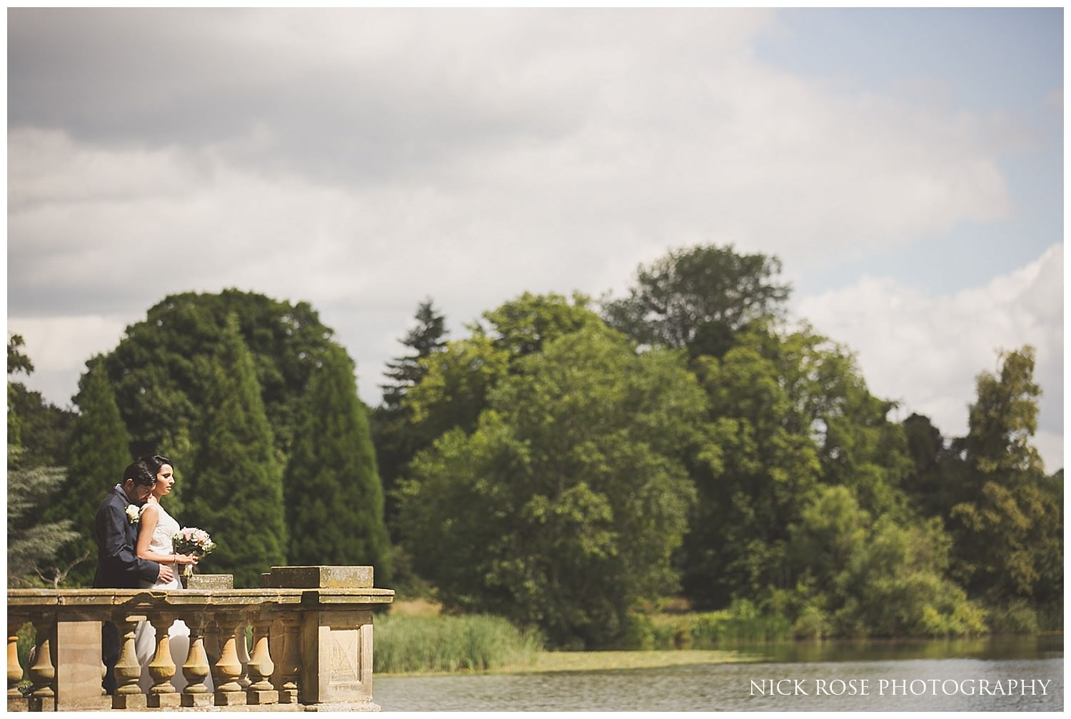 Lakeside wedding portrait photograph by the lake at Hever Castle in Kent