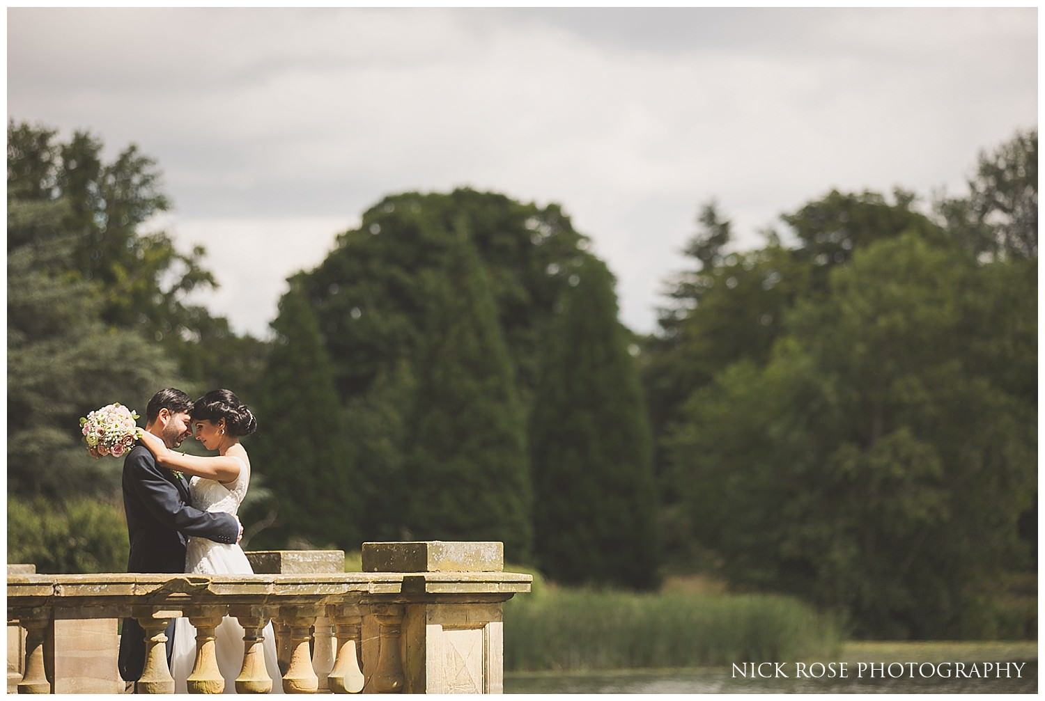 Wedding portrait photograph at the lake in Hever Castle Kent