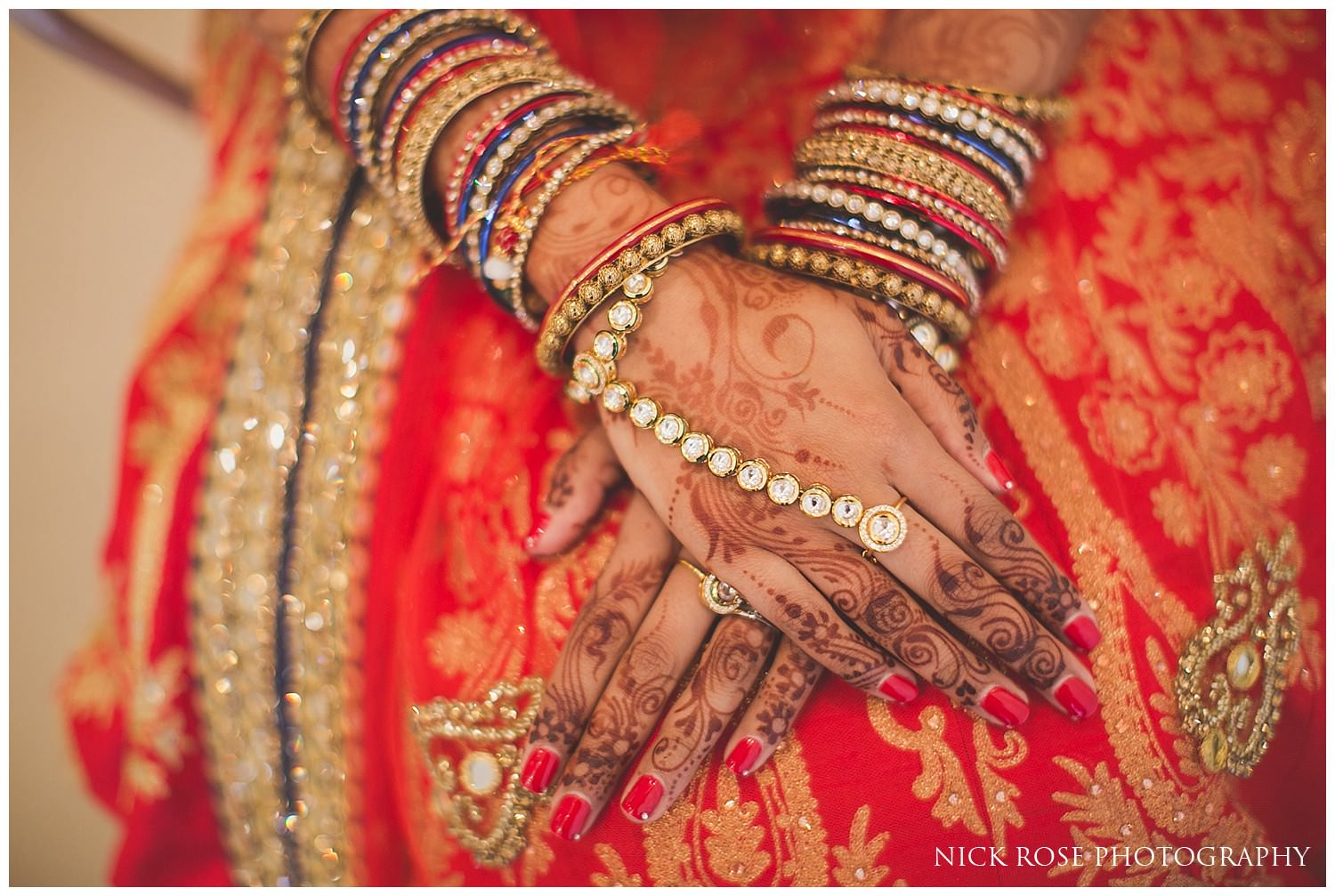 Indian bride with hands crossed on lap for an East Wintergarden wedding in Canary Wharf London