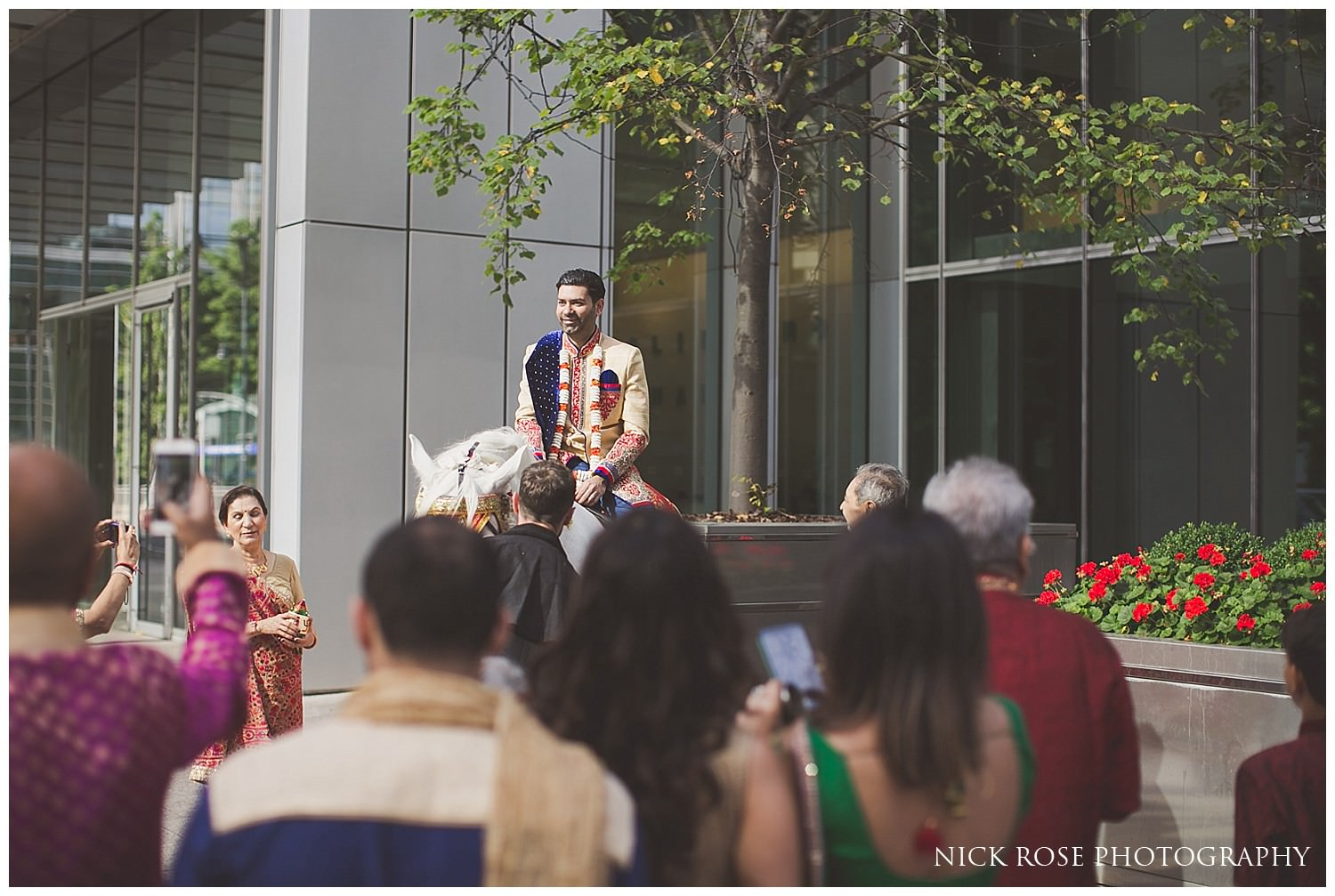 Groom on a horse getting ready for his Hindu wedding Baraat in London
