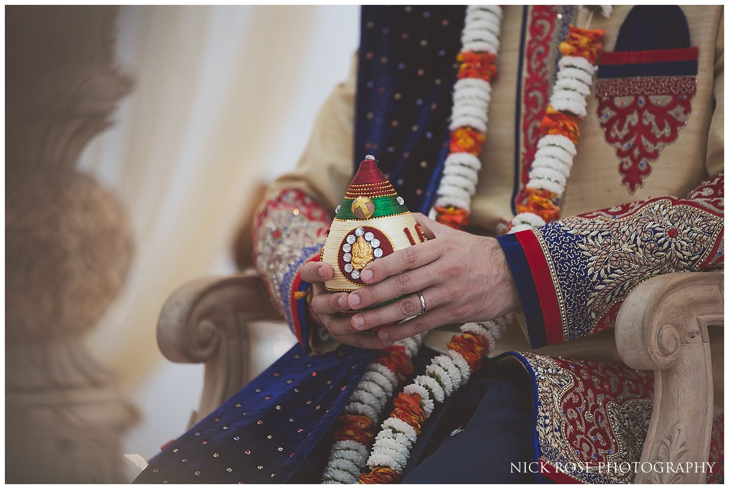 Close up photograph of groom's hands during a Hindu ceremony at East Wintergarden in Canary Wharf