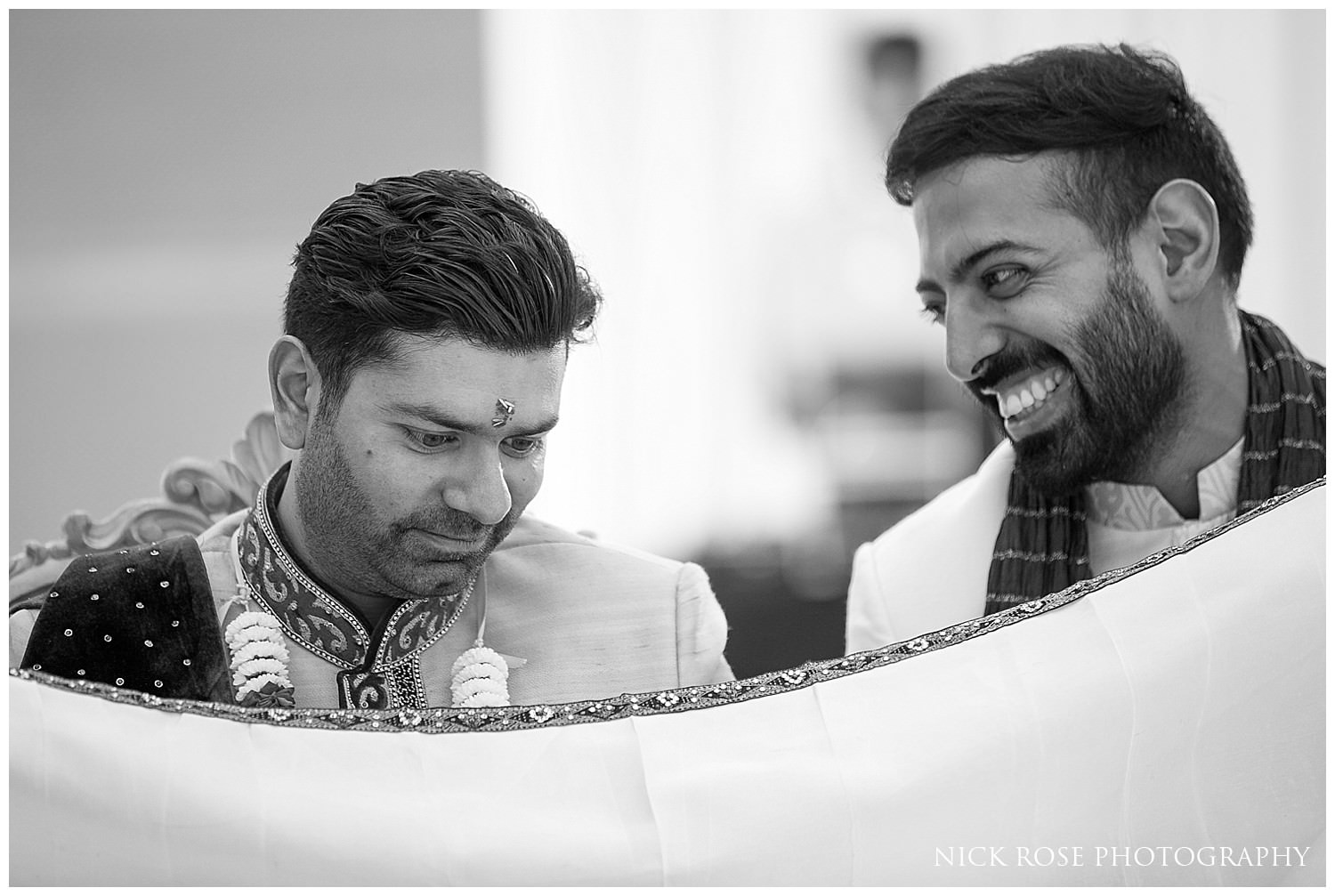Indian groom waiting for the brides entrance during a London Hindu wedding ceremony in East Wintergarden