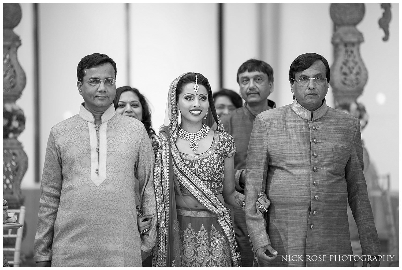 Bride entering an East Wintergarden Hindu wedding in Canary Wharf London