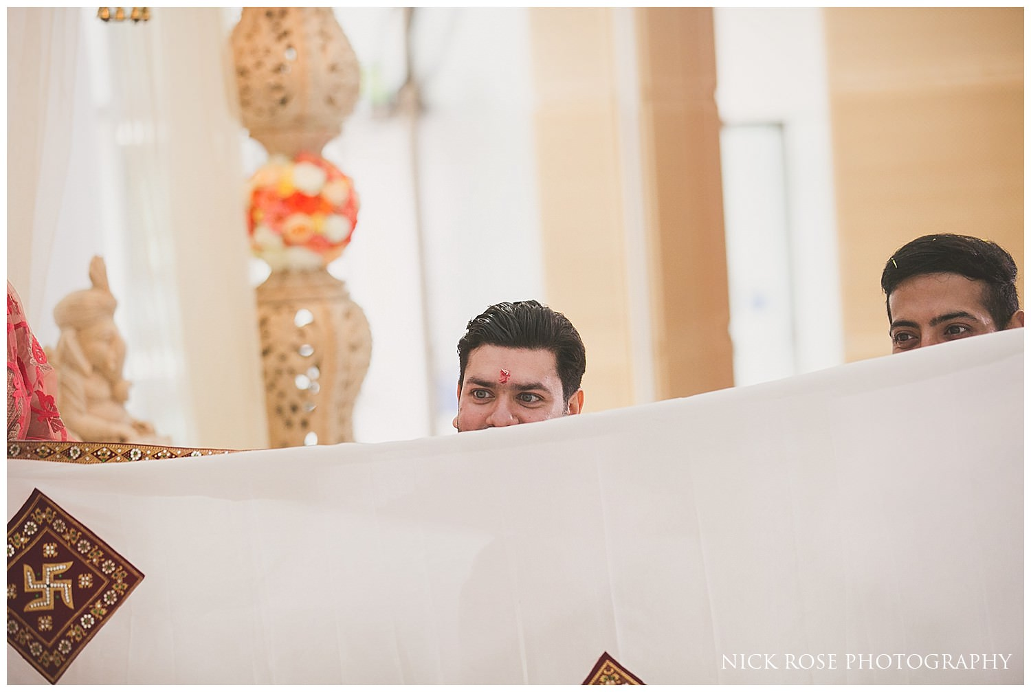 Groom seing his bride for the first time at an East Wintergarden Hindu wedding in Canary Wharf London
