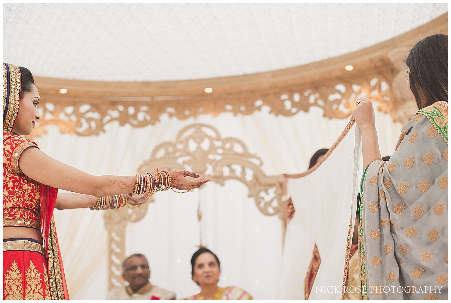 Bride ceremony reveal at East Wintergarden during a Hindu wedding in Canary Wharf London