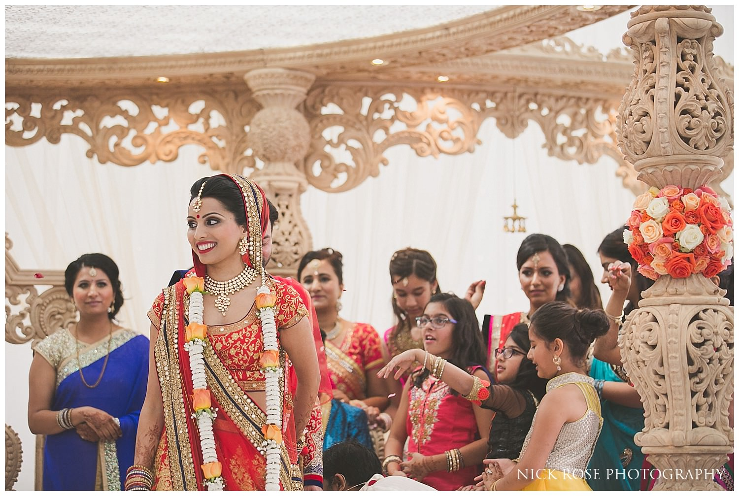 Asian Hindu wedding taking place in the East Wintergarden at London's Canary Wharf