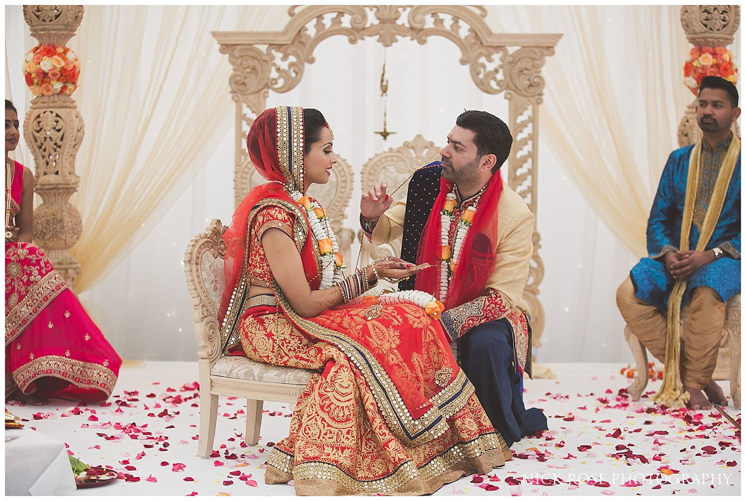 Bride and groom during their Asian Hindu wedding in the East Wintergarden at Canary Wharf London