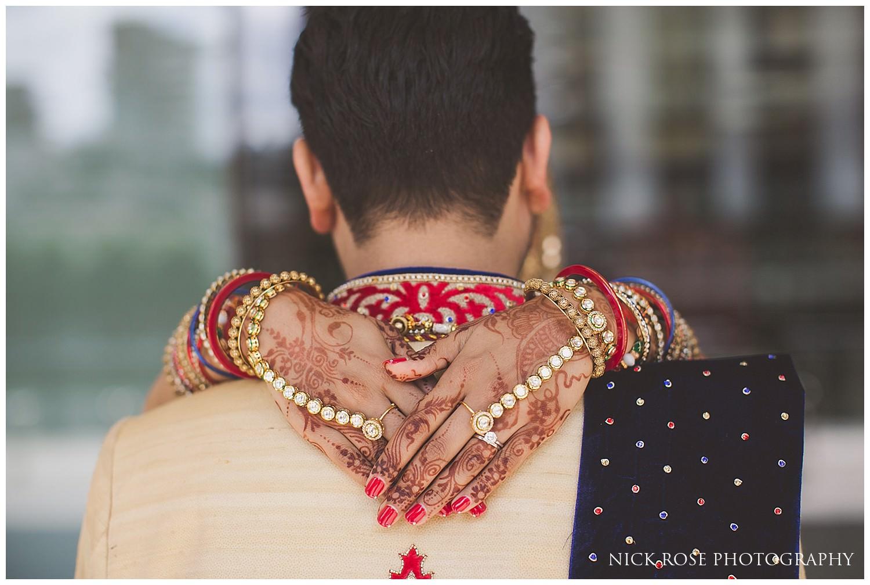 Indian bride with her hands over her grooms shoulders