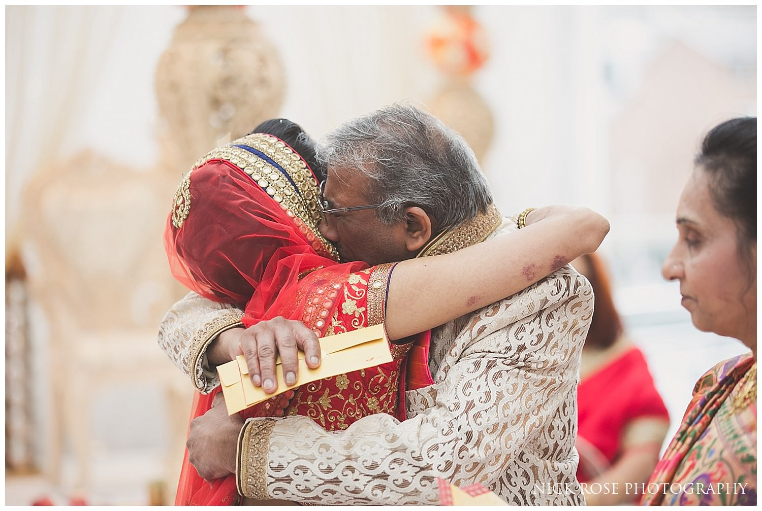 Brides father and bride's emotional farewell during the Hindu wedding viddai at East Wintergarden in London