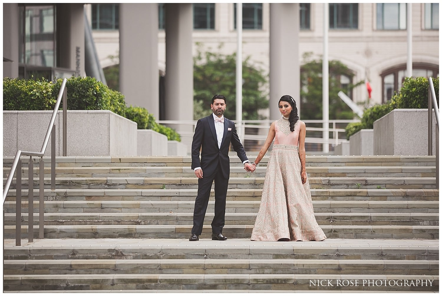 Asian bride and groom photograph before their Indian wedding reception in Canary Wharf London