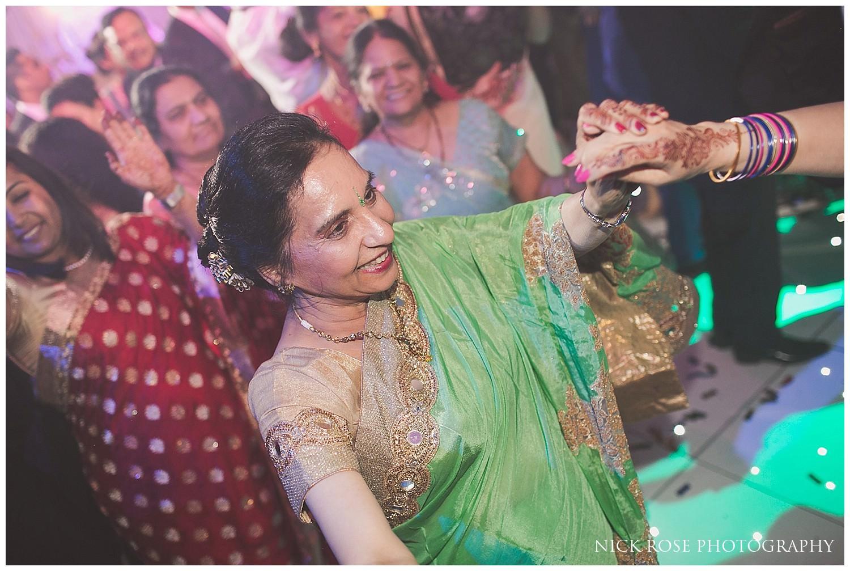 Hindu wedding dancing at Indian wedding reception in Canary Wharf London