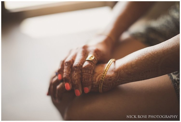 Bride sitting with her hands on her lap getting ready for a Hindu wedding in Dubai
