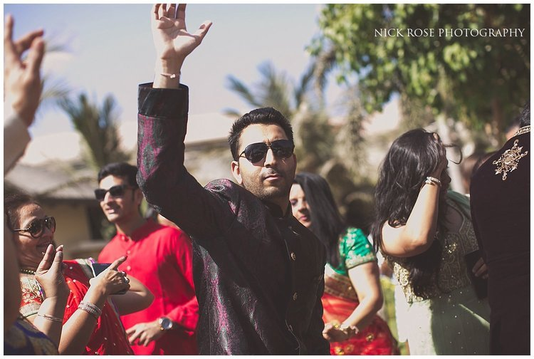 Energetic dancing for an outdoor Hindu wedding Baraat in Dubai