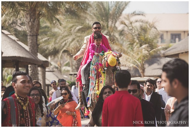 Groom entering a Hindu wedding in Dubai on a camel