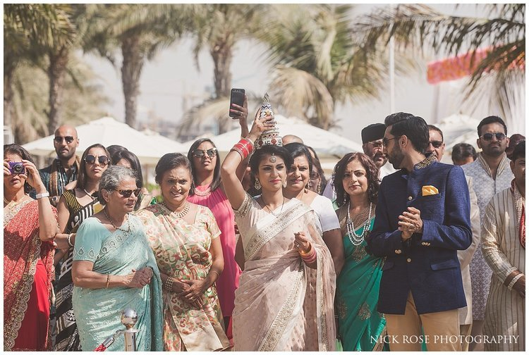 Brides family waiting for the groom to enter a Hindu wedding ceremony at the Sofitel Palm Dubai