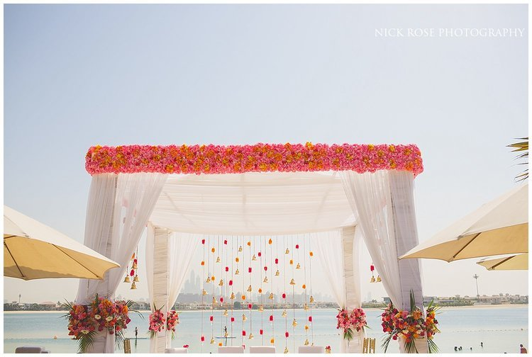Mandap set up on the beach for a destination Hindu wedding at Sofitel Palm Dubai