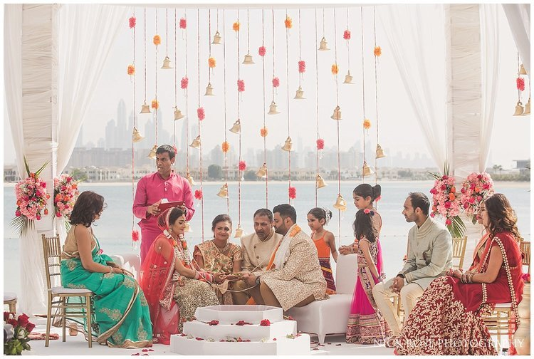 Hindu priest Kamal Pandey performing a wedding ceremony on the beach at the Sofitel Palm Dubai