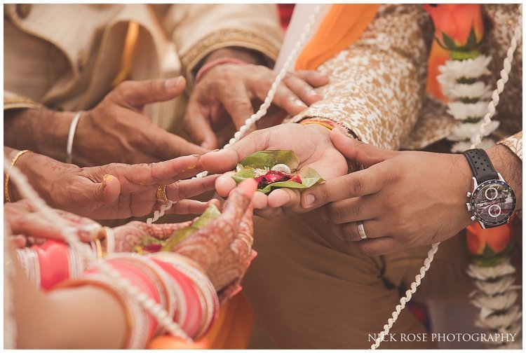 close up photograph of wedding couples hands during a Hindu wedding ceremony in Dubai