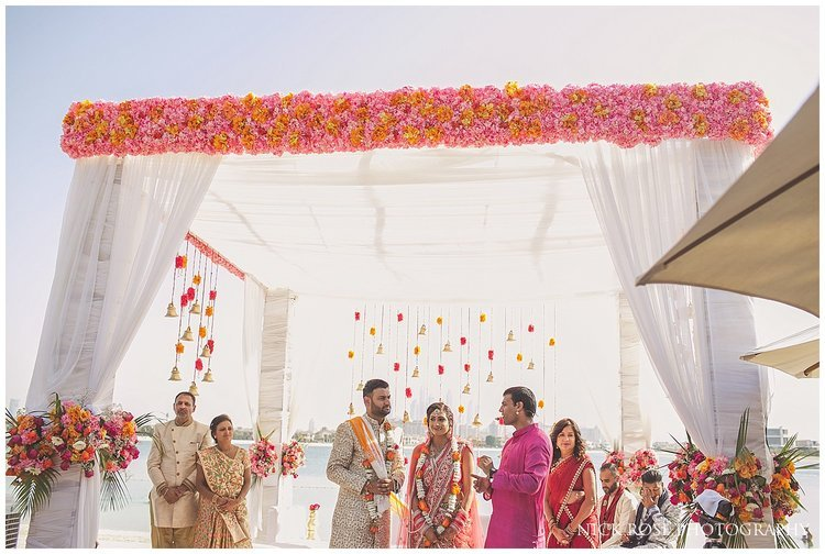 Asian couple getting married under a Mandap for an Indian wedding in Dubai