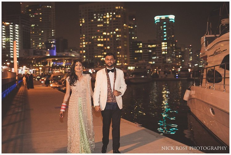 Bride and groom arriving for a private yacht wedding reception at Dubai marina