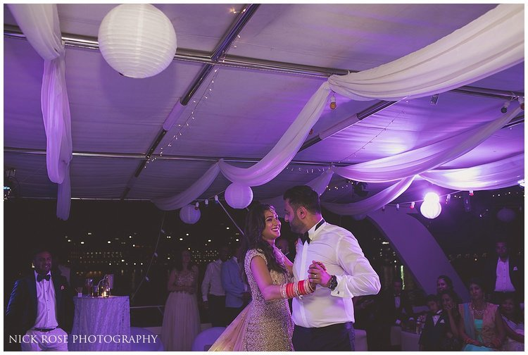 Couple first dance during a Hindu wedding reception in Dubai