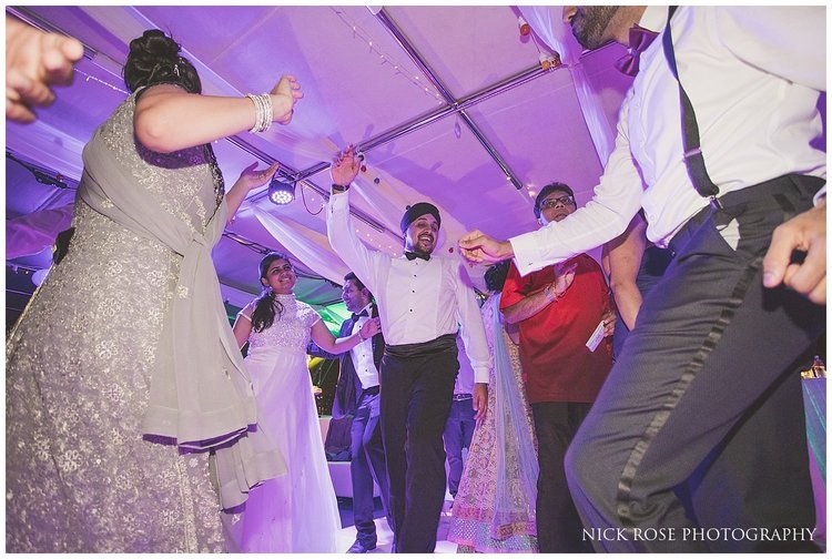 Guests having fun on the dance floor at a Hindu wedding reception at the Dubai Marina Yacht Club
