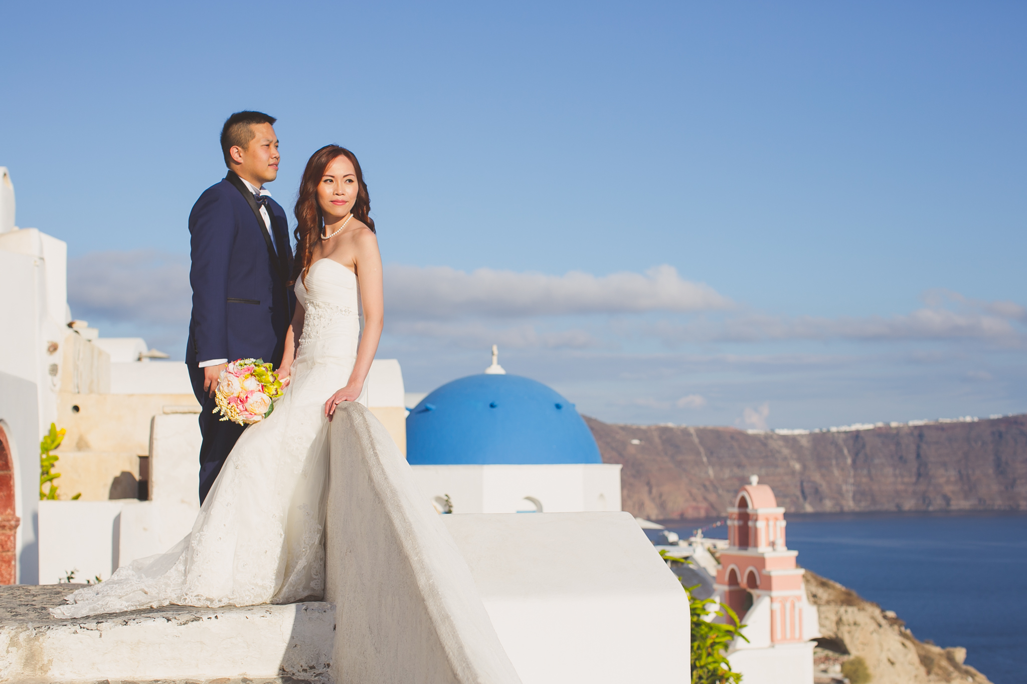 Destination pre wedding photography with blue roofs in Santorini Greece
