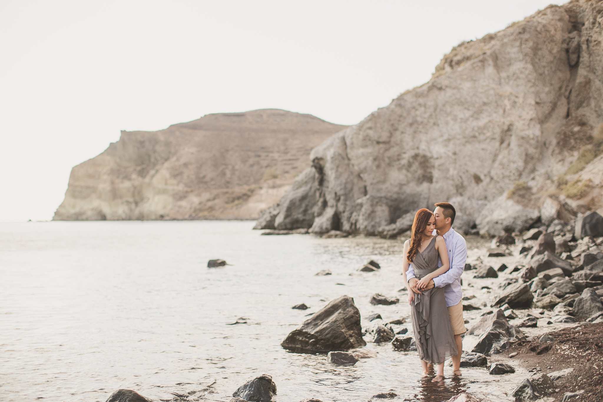 Pre wedding photography on the beach at Santorini during a destination engagement shoot