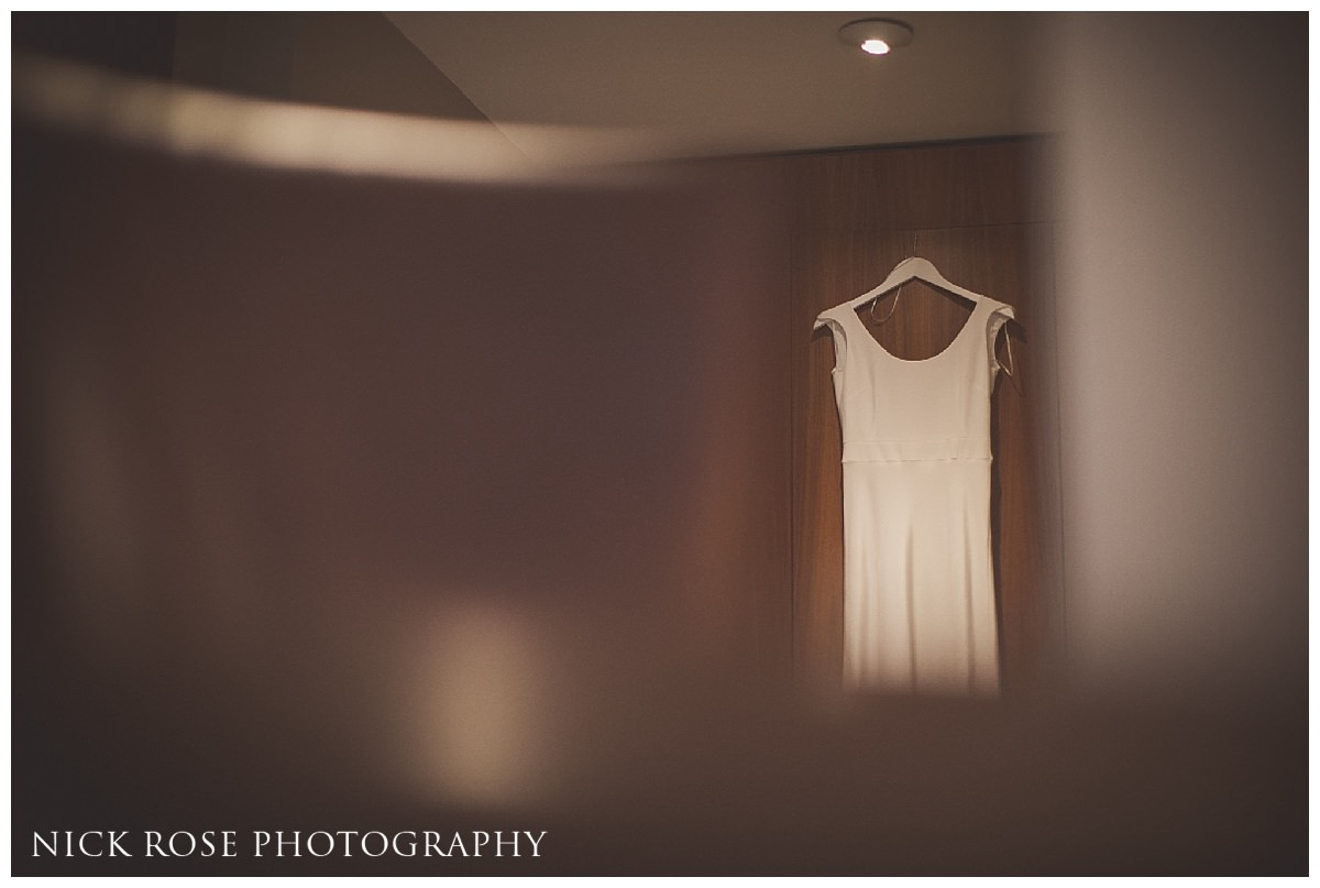Wedding dress hanging on door at Threadneedles Hotel in London