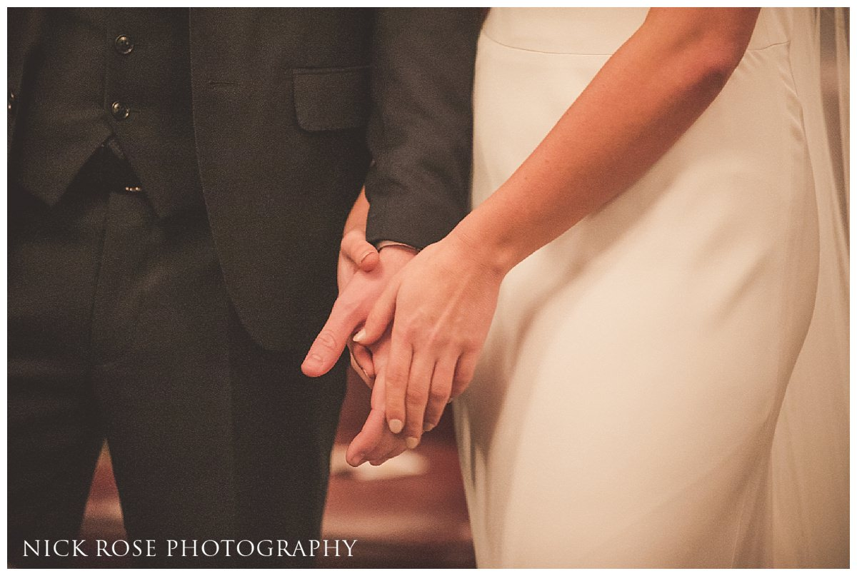 Bride and groom holding hands during a Hawksmoor Guildhall wedding ceremony in London