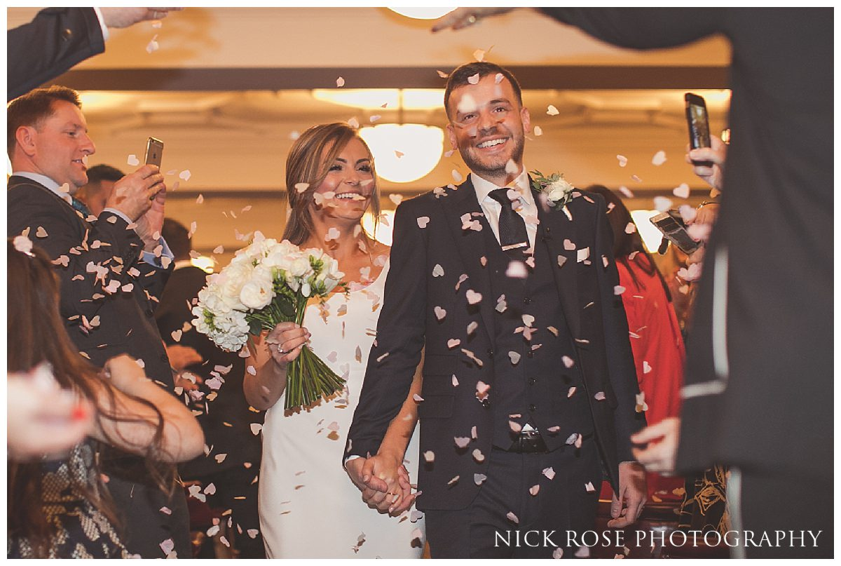 Bride and groom confetti photograph outside Hawksmoor Guildhall