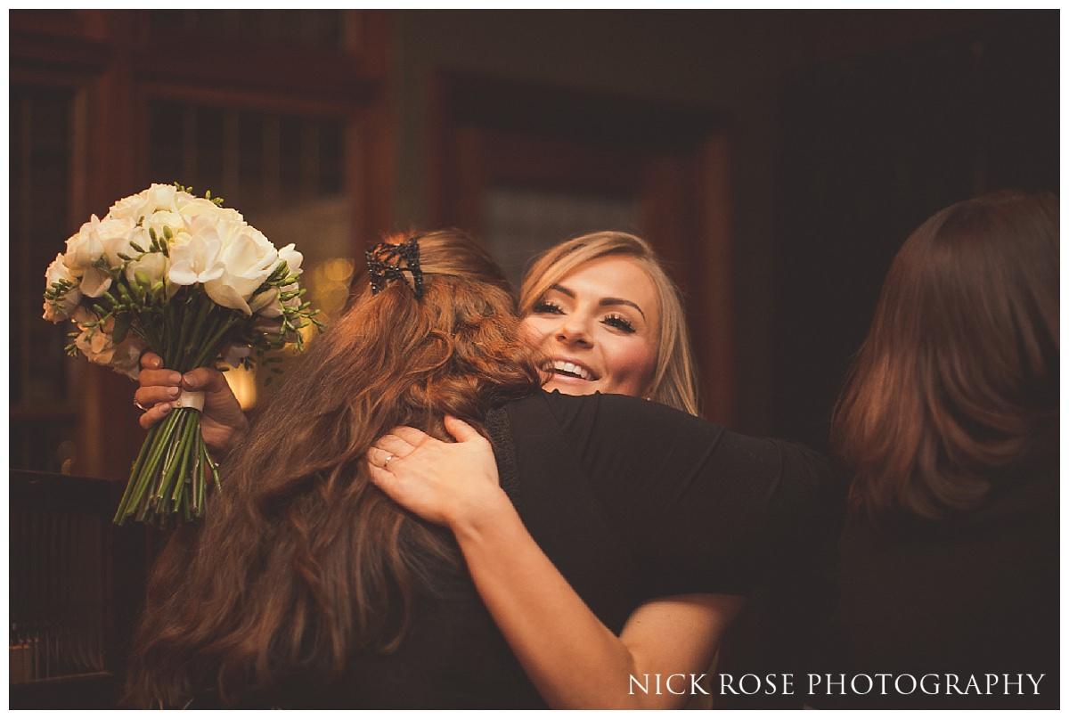 Bride hugging guest after Hawksmoor Guildhall wedding ceremony in London