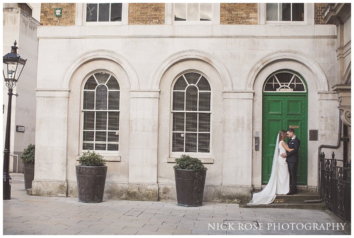 Couple in front of a green door at Guildhall London