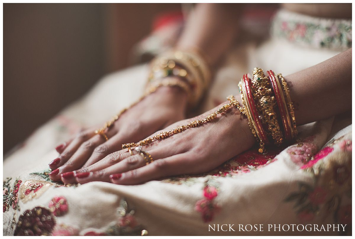 Hindu bride with hands on her lap before her wedding ceremony at the grove