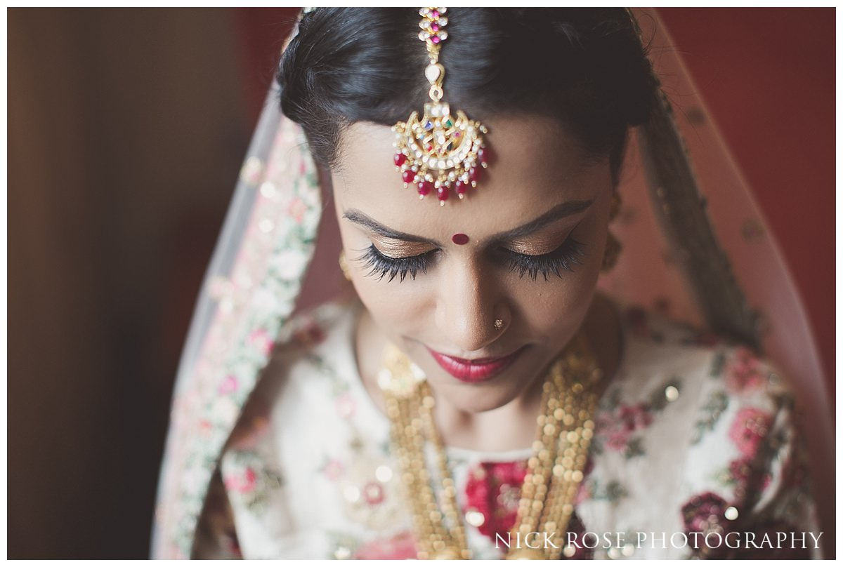 Beautiful Hindu bride before her Hindu wedding ceremony at The Grove in Hertfordshire