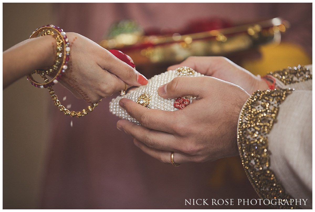 Groom holding a jewel encrusted coconut before a Hindu wedding ceremony at the Grove