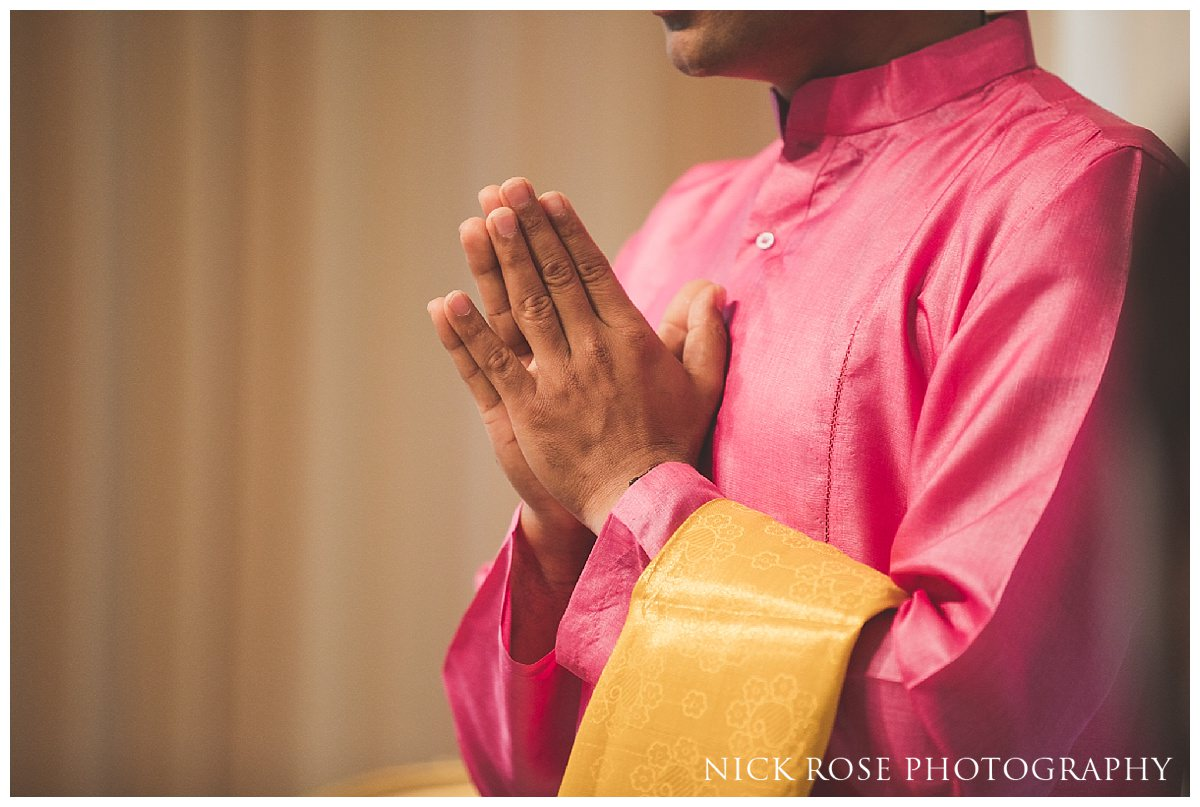 Hindu wedding priest Kamal Pandey praying during the wedding ceremony