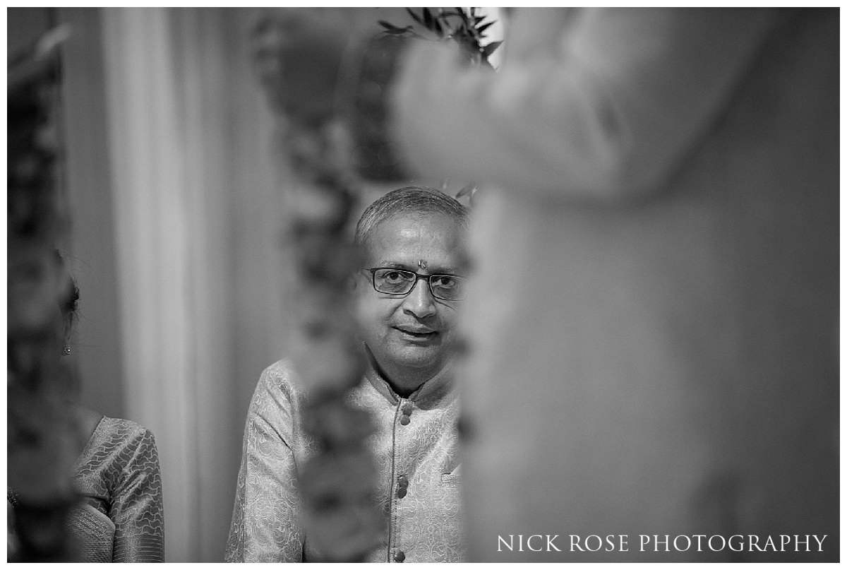 Brides father looking on during an Indian wedding