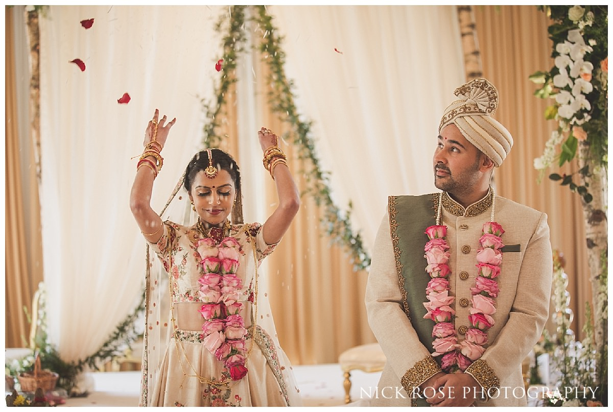 Hindu bride throwing rice after her wedding ceremony at The Grove