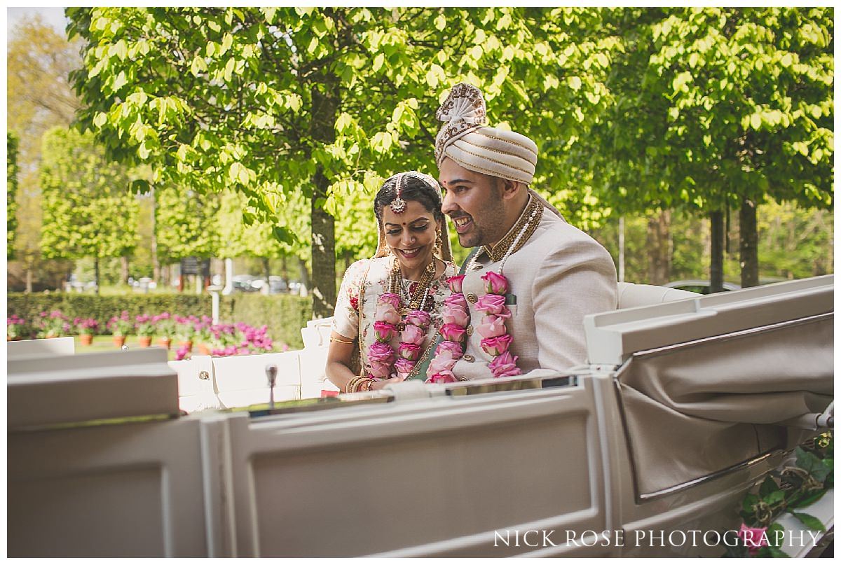 Bride and groom exiting a Hindu wedding at The Grove on a horse and carriage