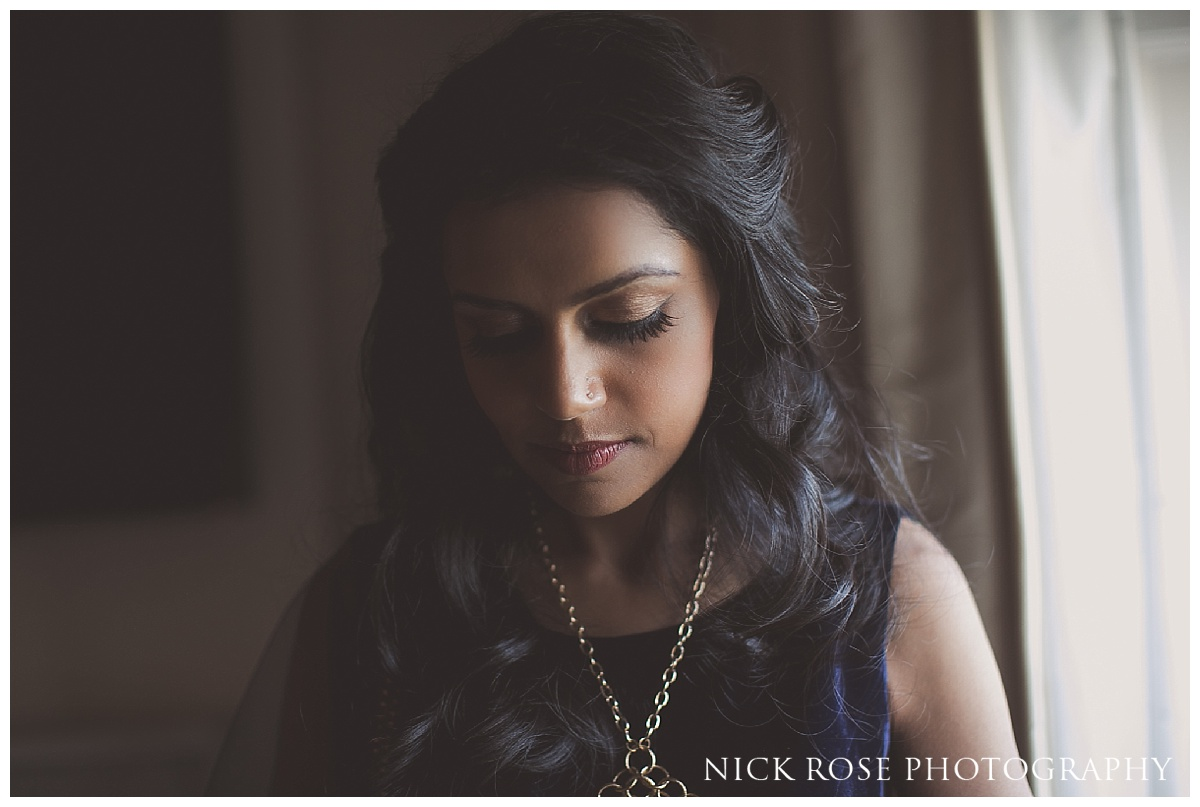 Indian bride getting ready for a Hindu reception at The Grove in Hertfordshire
