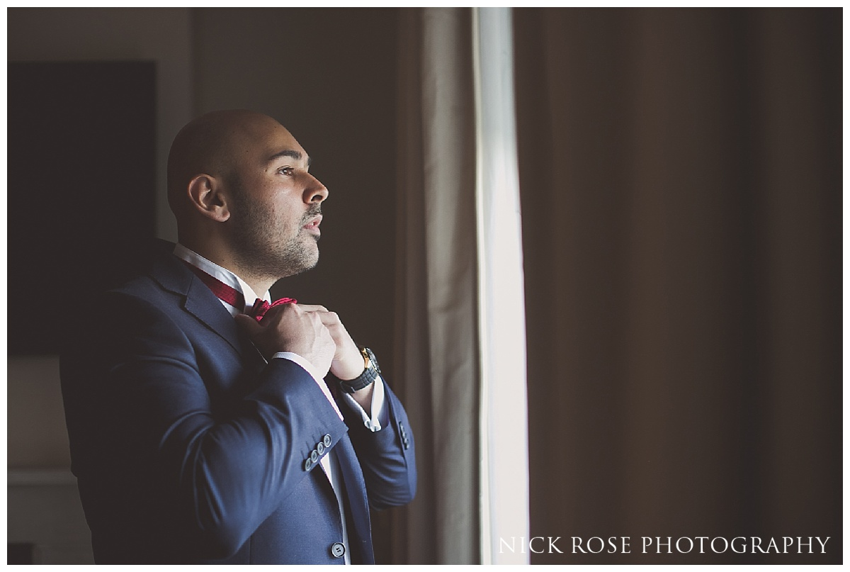 Indian groom getting ready for a Hindu reception at The Grove in Hertfordshire