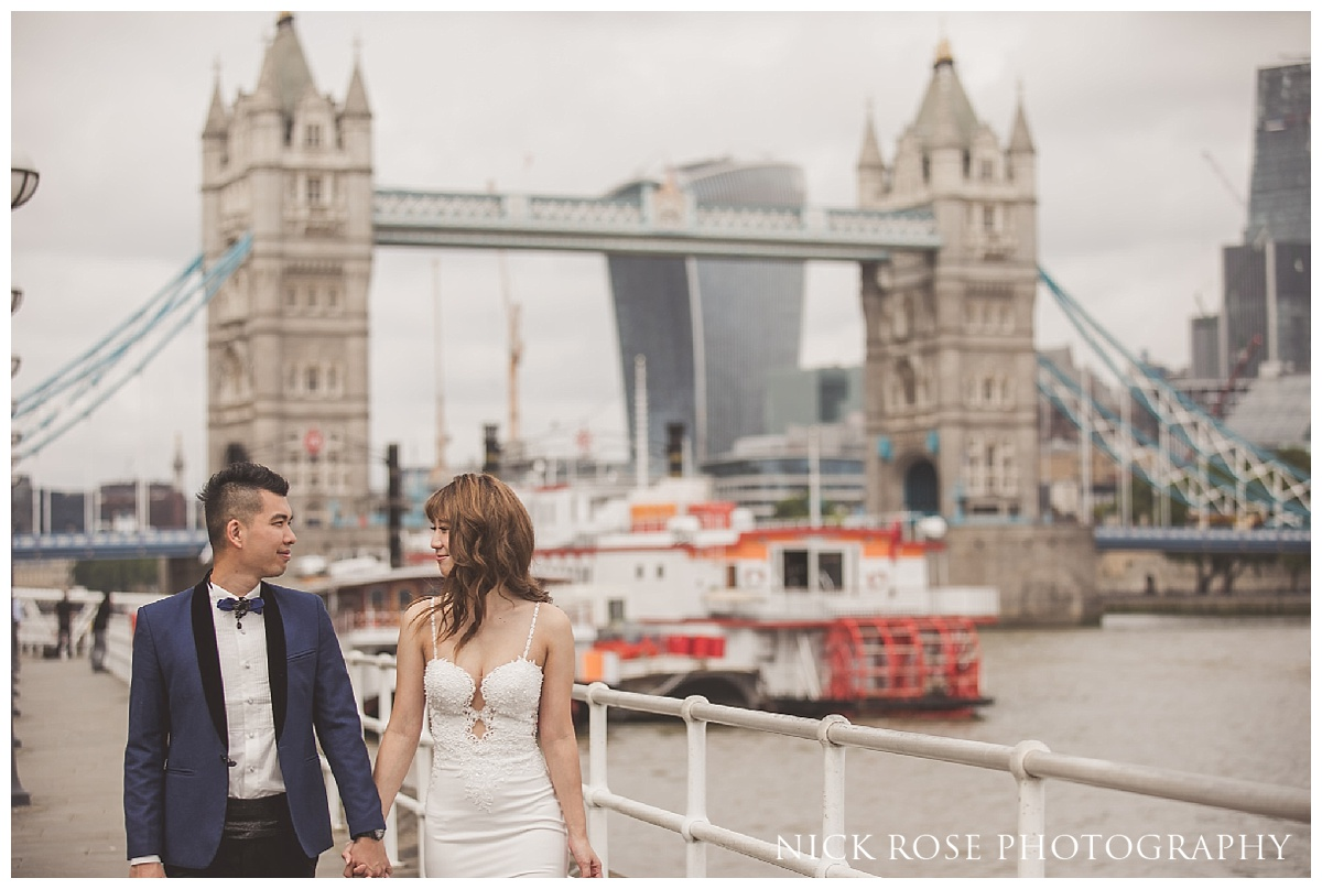 Bride and groom in front of Tower Bridge during a London pre wedding photography shoot