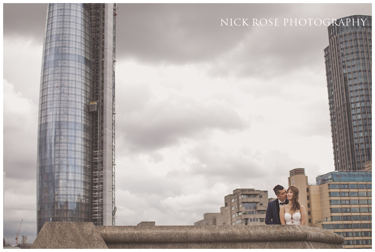 Engagement photography on a bridge over the River Thames in London